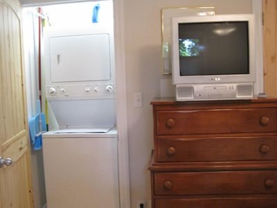 Washer/Dryer in closet in the cottage.TV has a DVD player.