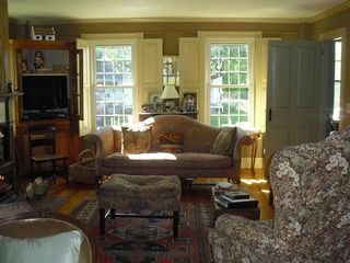 Weston house photo - Bright Spacious Living Room With Warmth of Wood Stove