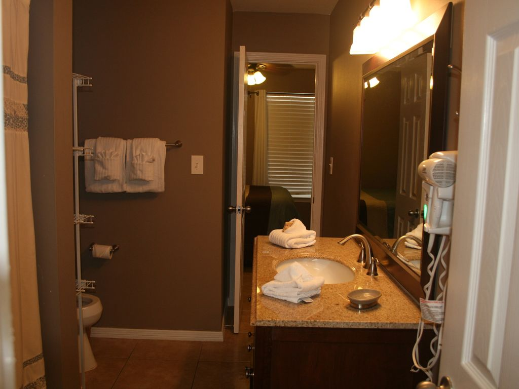 Another view of the bathroom with access to the bedroom and the kitchen