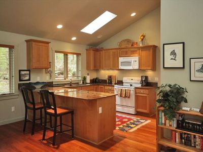 Hardwood floors, granite countertops  Sky lights and lighting