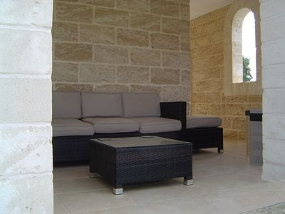 Veranda seating with coffee table.
