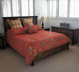 Master bedroom - California King size bed - with red bed spread