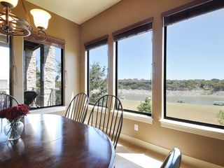 Spicewood house photo - Kitchen table (main floor) with view of lake