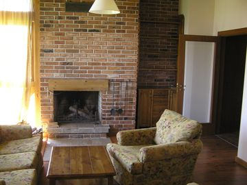 Lounge and log fireplace