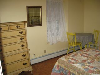Yellow bedroom, small table perfect for tea parties - Ocean Grove house vacation rental photo
