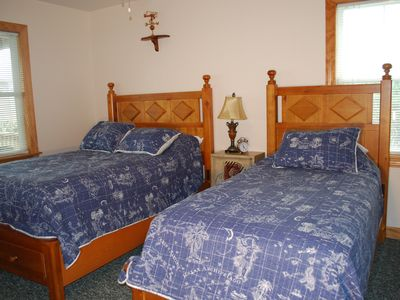 Bedroom on second level with one full and one twin bed and attached private bath
