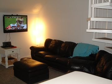 Ipod dock, DVD player, flat-screen and plenty of seating in living room
