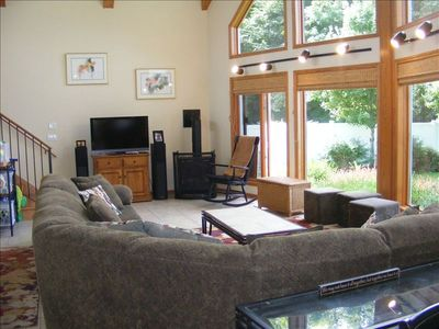 Large Living room, with TV, fireplace, with large windows for viewing Lake MI