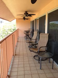Penthouse 40' porch overlooking the Gulf of Mexico beach, lounge chairs and fans