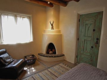 Kiva Fireplace in Double Bedroom