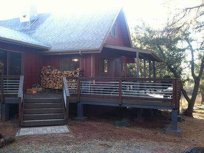 Pine cabin rental - Our newly finished back deck, plenty of firewood right outside the family room.