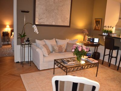 Feels like your home away from home with flowers, orchid plant, area rugs...