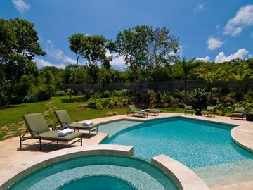 The pool and hot tub are set in a delightful garden with view of the golf green