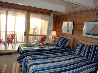 Second floor oceanfront bedroom has its own screened porch overlooking the surf