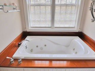 Katama house photo - Master Bath Has Whirlpool Tub With Yacht-Style Mahogany Surround