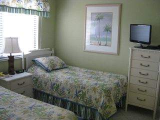 Seawinds condo photo - New tropical themed bedding in guest bedroom