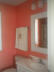 "Alexandria house photo - The ""tangerine"" bathroom includes a walk-in shower."