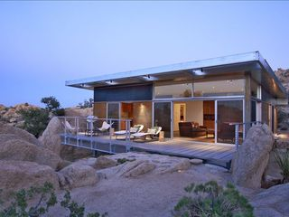 Yucca Valley house photo - Rock Reach House floats over the desert boulderscape (Nuvue Interactive)