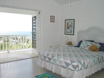 Top floor bedroom with private balcony