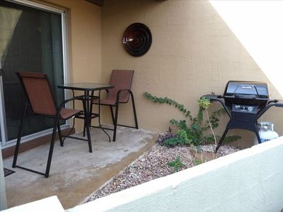 Private covered Patio with dining area & gas grill.