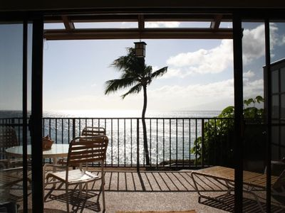 The living room looks onto a large lanai and has a panoramic ocean view.