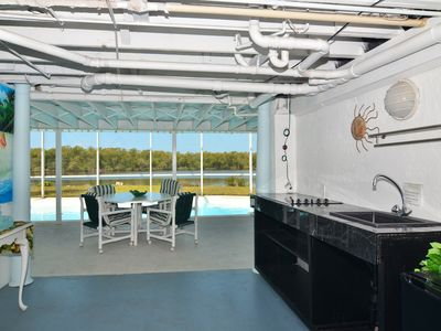 Shady breezeway, small fridge, wetbar, cook top, beach chairs, grill,beach stuff