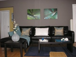 Boca Raton house photo - ... or hang out on the comfy leather sofa in front of your flat screen TV...