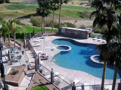 Lake Havasu condo rental - Pebble lagoon shaped pool FROM CONDO COMPLEX barbacues & tables out of pictu