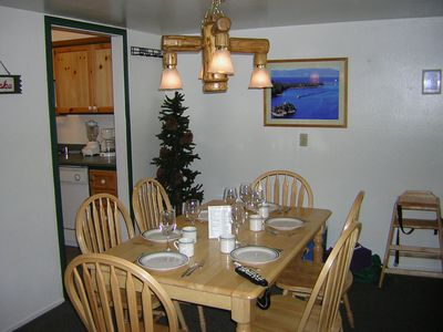 Dine under our wood-log chandelier. High chair for our smaller guests.