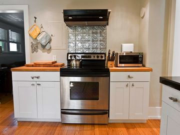 Butcher block countertops + a complete set of appliances
