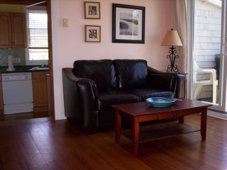 Provincetown condo rental - Living room with love seat and sliders to deck