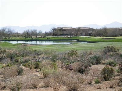 looking at condo from golf course-condo is in back -views of mountains/desert