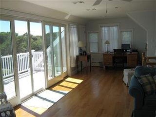 West Dennis house photo - Great room with deck access and desk set up for some dreaded work
