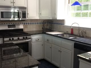 Bourne house photo - kitchen with full amenities and plenty of place servings!