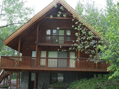 Large 3 Story Wood Cabin Nestled in the Trees.