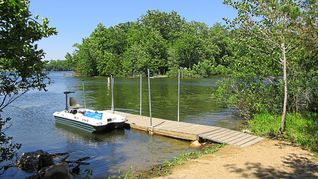 Shakopee cottage photo - Our mainland beach. Island is in the background, about 135 ft across the lake.