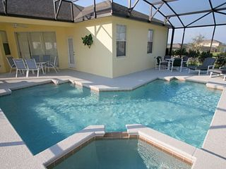 Haines City house photo - Large 'L' shaped pool and Spa with 2 seating areas