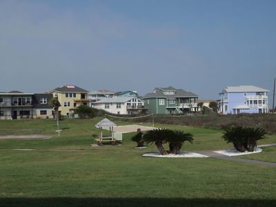 Back patio view of sports court and newly built homes