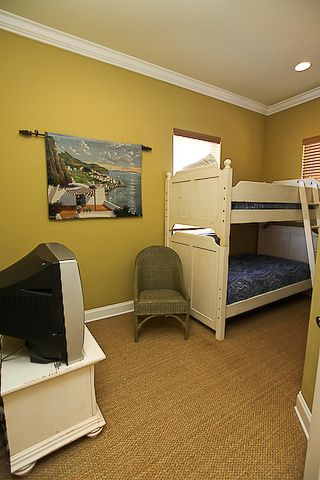 2nd floor bunk room with 2 sets of bunk beds (4 twins). Other bunk bed to right