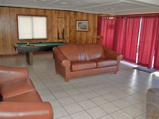 Gatlinburg chalet photo - Rec. room on lower level with pool table, TV and hot tub on the deck