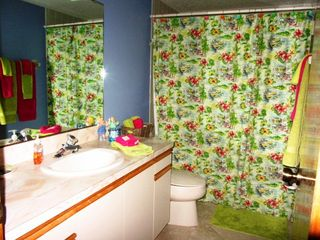 Guest Bath with shower and tub - Cocoa Beach condo vacation rental photo
