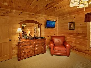 "Pigeon Forge cabin photo - Spacious Master Bedroom w/32""LEDtv, DVD, Seating main floor"