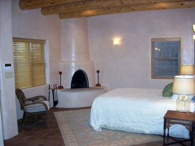 Second bedroom, wood burning kiva fireplace, separate entry to house