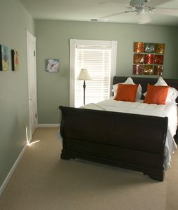 Bright and fresh queen beds upstairs.