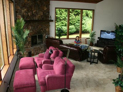 Living room with movie area and reading area (All windows shown have lake view).
