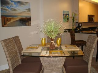 Biloxi condo photo - Dining area opens to kitchen and living room.