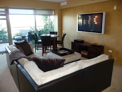 Comfortable Family Room with LARGE Flat Screen TV
