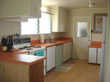 The kitchen is spacious and fully equipped with everything you need for meals.