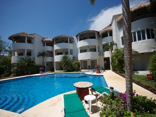 Playacar condo photo - Large common areas with big pool. Great for sunbathing, pool volleyball, etc