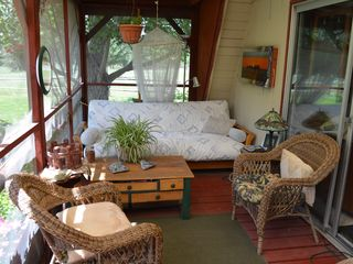 Lake Roosevelt house photo - Sleep 2 on sceened in porch with eating area and fireplace. Wake up to deer.